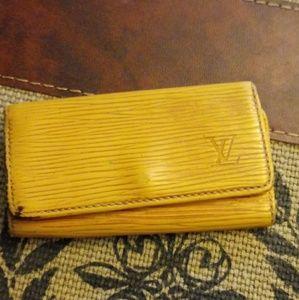 Authentic Louis Vuitton Epi Yellow 4 key holder.